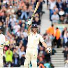 Ben Stokes, right, celebrates his century (Adam Davy/PA)