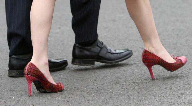 The UK Government rejected calls for a ban on enforced high heel wear (Jonathan Brady/PA)