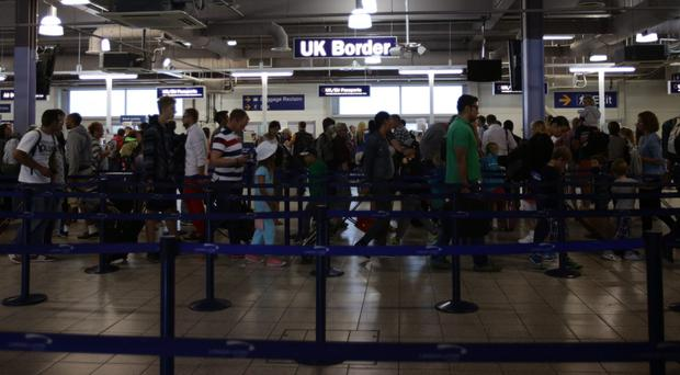 New passport control rules mean UK holidaymakers face long queues at airports (Yui Mok/PA)