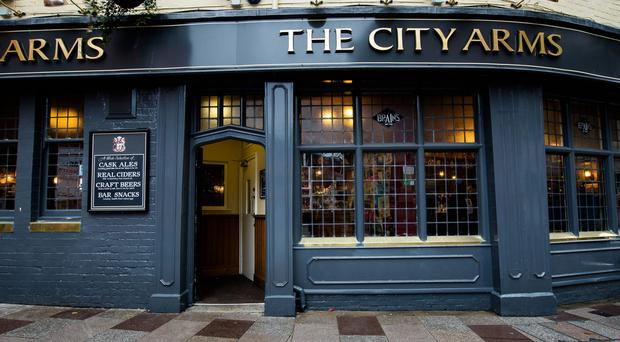 The trainee priests were initially turned away from the City Arms pub in Cardiff (PA)