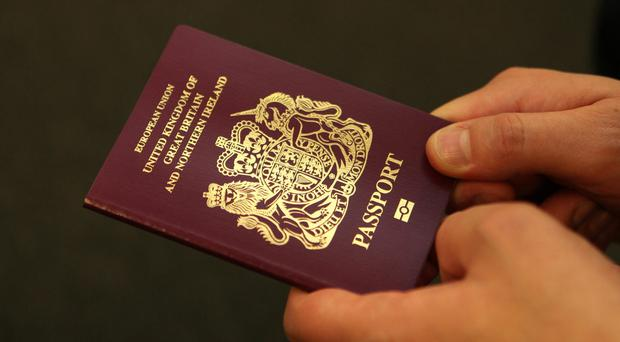An American has been accused of using a fake Great Britain passport for close to 20 years ( Katie Collins/PA)