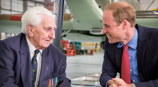Flying Officer Ken Wilkinson with the Duke of Cambridge (SAC Megan Woodhouse (RAF)/PA)