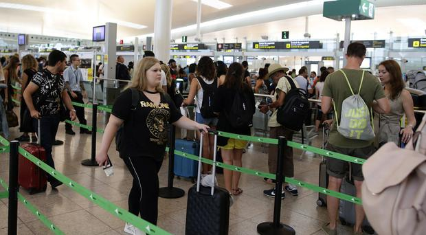 Passengers queue for security checks in Barcelona (Manu Fernandez/AP)