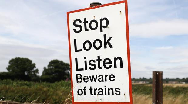 A rail safety sign (Andrew Matthews/PA)