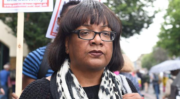 Diane Abbott called for peace following violent demonstrations in Hackney (PA)