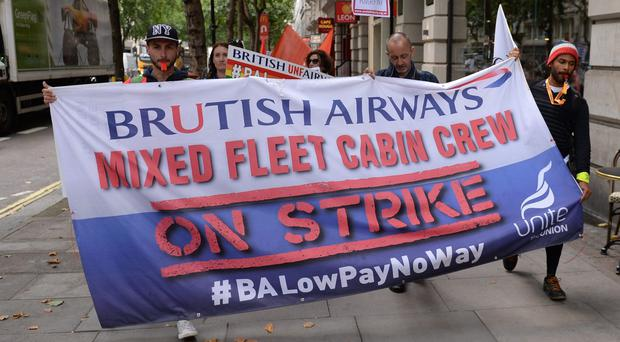 BA cabin crew protest outside the Civil Aviation Authority in central London (Stefan Rousseau/PA)