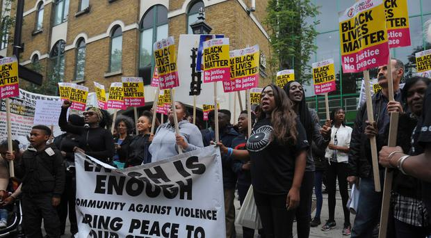Members from Hackey Stand Up To Racism protest outside Stoke Newington Police Station (PA)