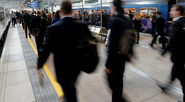 The average commute for rail passengers from home to work was over an hour (Andrew Matthews/PA)