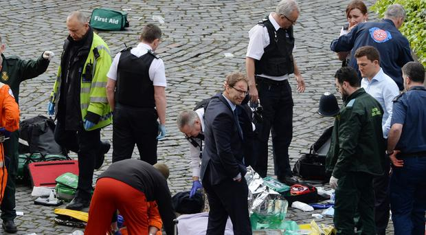 Tobias Ellwood, centre, has had to deal with telling his son how he tried to save the life of stabbed policeman Keith Palmer (Stefan Rousseau/PA)