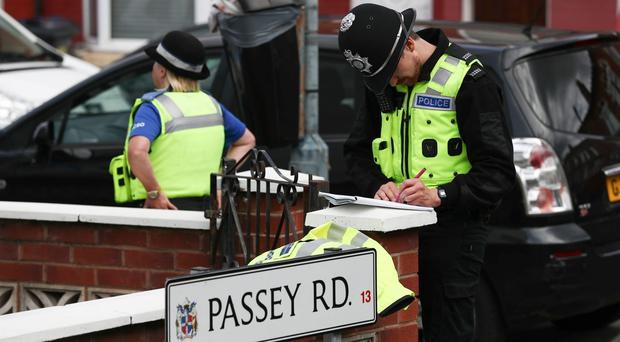 A 40-year-old man has been stabbed to death on his doorstep in what police are calling a