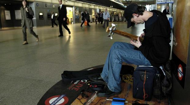 The number of buskers allowed to perform at London Underground stations is set to increase by up to 40% (PA Wire)