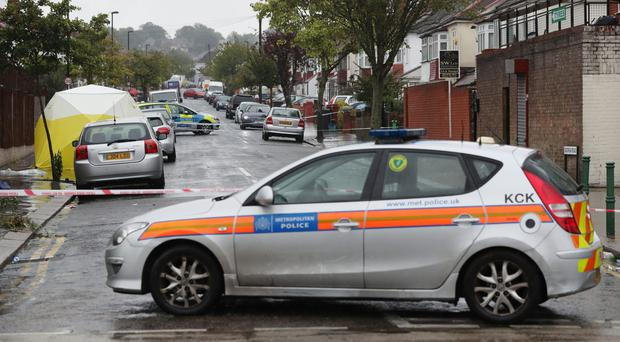 Police at the scene in Thornton Heath, south London, where a 15-year-old boy was stabbed to death (Jonathan Brady/PA)