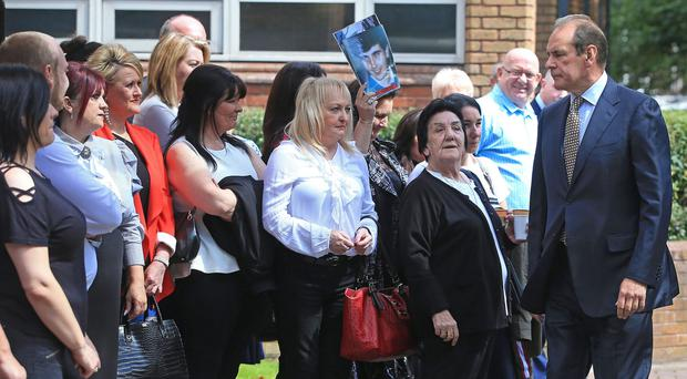Former West Yorkshire and Merseyside chief constable Sir Norman Bettison walks past friends and family of Hillsborough victims as he arrives at Warrington Magistrates' Court (Danny Lawson/PA)
