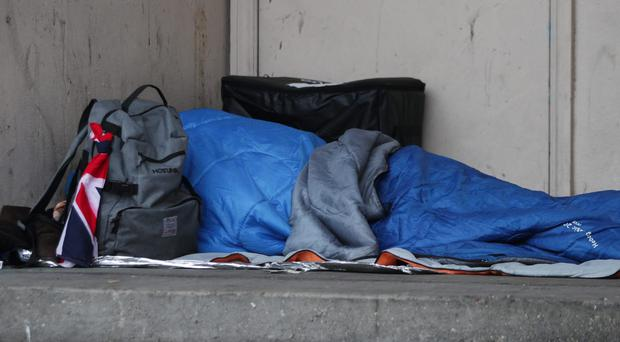 A homeless person sleeping rough (Yui Mok/PA)