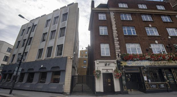 The three-metre gap between two buildings on Euston Road in central London where a house is going to be built (Victoria Jones/PA)