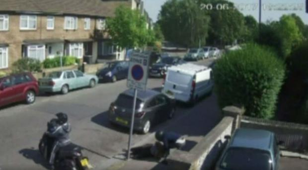 The attacker jumped on the back of a moped to make his escape (Screengrab/PA)