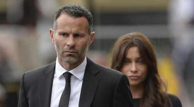 Ryan Giggs and Stacey Cooke married in September 2007 and have two children (Joe Giddens/PA)