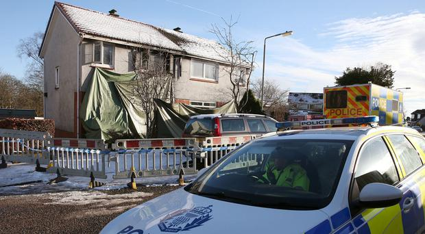 Police at the scene of a fire in Milngavie (Andrew Milligan/PA)