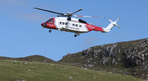 A Coastguard helicopter came to the rescue (Andrew Milligan/PA)