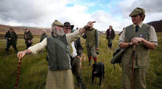 Head gamekeeper Graeme MacDonald (left) leads a shooting party on the moors at the Alvie Estate near Aviemore (Jane Barlow/PA)