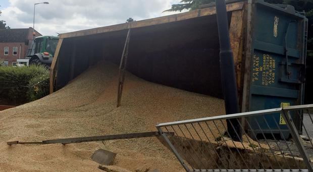 Tons of grains spilled onto a path in Maidenhead town centre (Peter Clifton/PA)