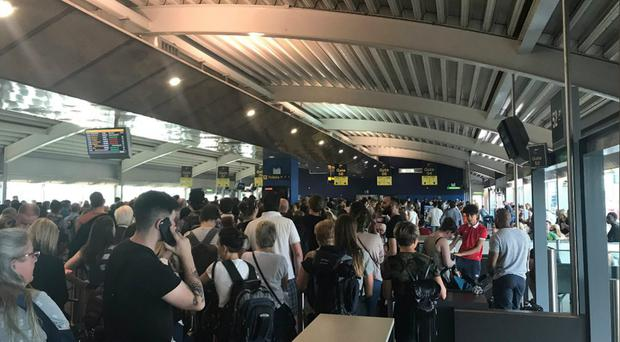 Passengers queuing at Stansted Airport after the runway was closed for repairs (@LisaParker83/PA)