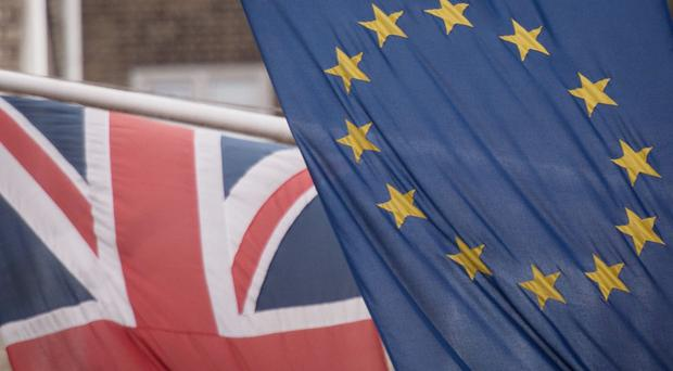 The number of EU citizens working in the UK has hit a new record high (Stefan Rousseau/PA)