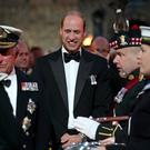 The Prince of Wales, known as the Duke of Rothesay in Scotland, and the Duke of Cambridge attend the Royal Edinburgh Military Tattoo at Edinburgh Castle (Jane Barlow/PA)