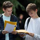 Twin Students James (left) and Toby Houston after collecting their A-level results (Andrew Matthews/PA)