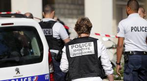 French police at the scene of the attack in Levallois-Perret (Kamil Zihnioglu/AP)
