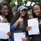 Students (left to right) Jessica Yeboah, Simi Raud and Dedia Collier after collecting their A-level and BTEC results (Yui Mok/PA)