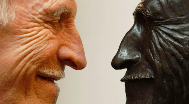 Sir Bruce checks out a bust of himself back in 2005 (Yui Mok/PA)