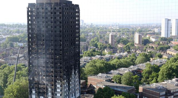 The charred remains of Grenfell Tower (Rick Findler/PA )
