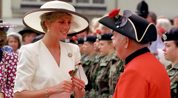The Princess of Wales chats with a Chelsea pensioner after he presented her with a rose (Martin Keene/PA)