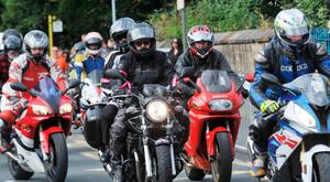 Family and friends attend the funeral of motorcylist Jamie Hodson