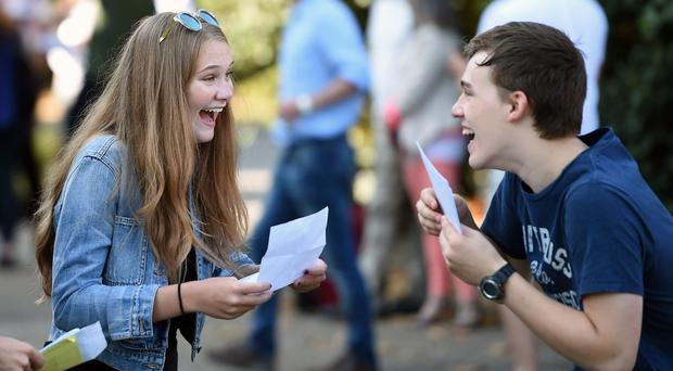 Students celebrate after collecting their GCSE results (Joe Giddens/PA)
