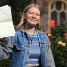 Jessica Olliver who was born profoundly deaf celebrates after collecting her GCSE results (Gareth Fuller/PA)