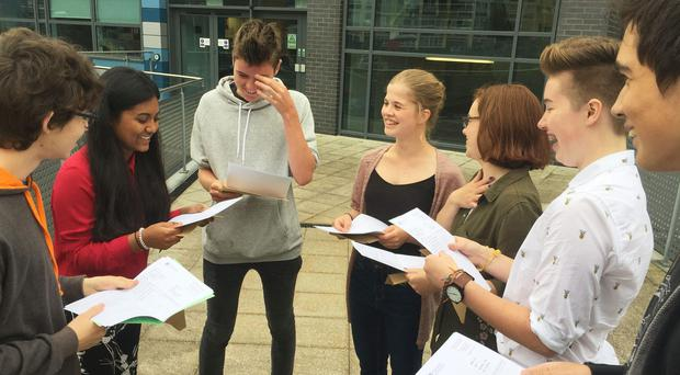 Students celebrate a string of top GCSE grades at St Mary and Temple School in Bristol. PRESS ASSOCIATION Photo. Picture date: Thursday August 24, 2017. See PA story EDUCATION GCSEs Redcliffe. Rod Minchin/PA Wire
