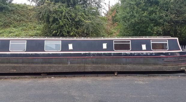 The narrowboat had been left blocking a pavement on an industrial estate in Smethwick (Sandwell Metropolitan Borough Council/PA)