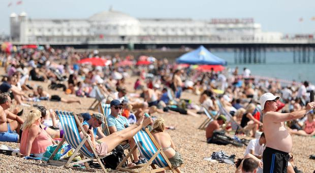 Crowds take advantage of the warm weather on Brighton Beach (Andrew Matthews/PA)