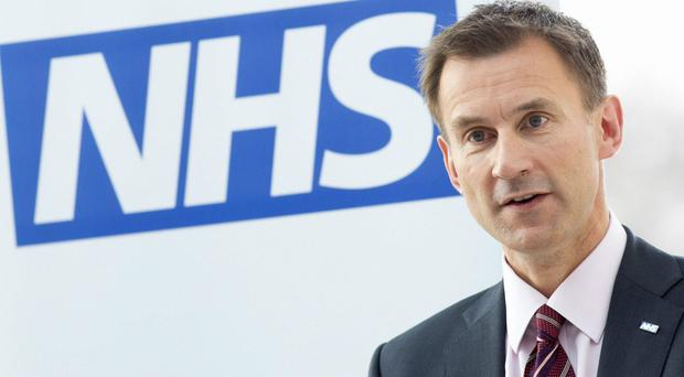 Jeremy Hunt details rejection of Stephen Hawking's claim NHS risks privatisation (Neil Hall/PA)