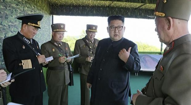 North Korean leader Kim Jong Un, second right, speaks with officials (AP)