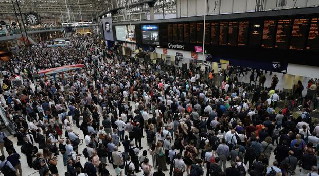 Commuters at Waterloo Station during the evening rush hour (Yui Mok/PA)