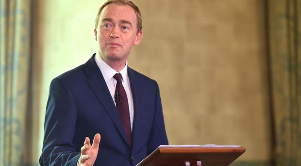 Former Lib Dems leader Tim Farron says football transfer fees and higher ticket prices is a result of Brexit (David Mirzoeff/PA)