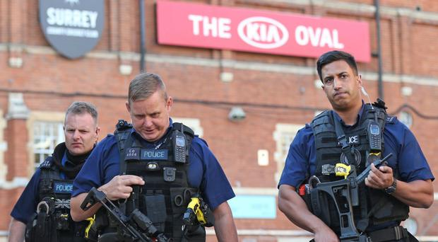 Police outside the Kia Oval ground in London after play was suspended (Jonathan Brady/PA)
