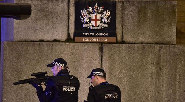 Armed police officers on London Bridge after the terrorist attack (Dominic Lipinski/PA)
