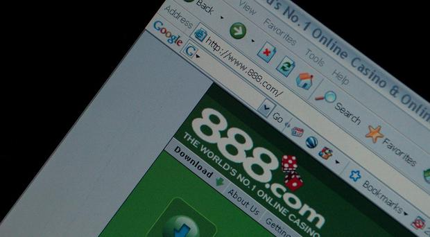 Online bookmaker 888 has recorded a half-year loss (Chris Radburn/PA)