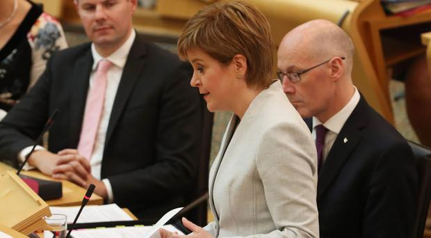 Nicola Sturgeon said education and cutting the attainment gap between rich and poor was her government's top priority (Andrew Milligan/PA)