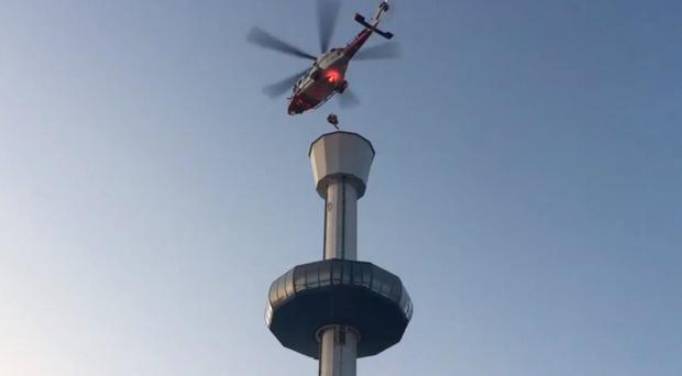 Coastguard helicopter rescues 13 people from Weymouth tower gondola (@DWFRSFireSafety/PA)