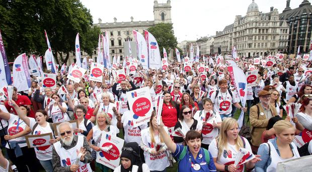 The demonstration came as a survey revealed that almost seven out of 10 people believe nurses are underpaid (Yui Mok/PA)